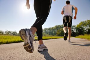young-couple-jogging-in-park-at-morning-health-and-fitness